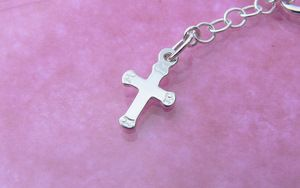sterling silver extension chain with a cross