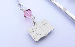 first holy communion bible charm on a bookmark